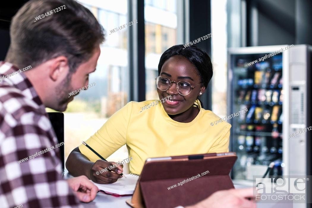 Stock Photo: Colleagues working together in a cafe.