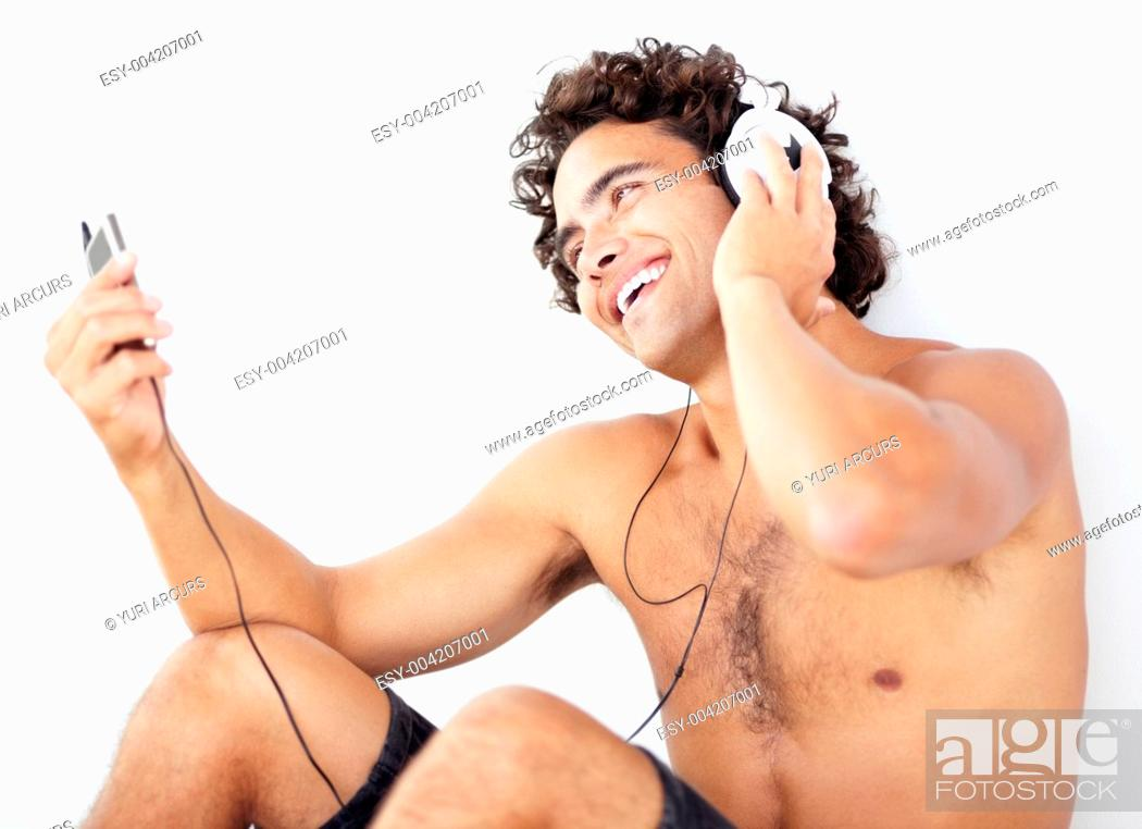 Stock Photo: A handsome young shirtless man listening to his mp3 player.