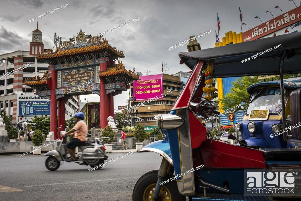 Stock Photo: Traffic, in Chinatown Gate, known as the Wongwian Odeon, in Bangkok, Thailand.