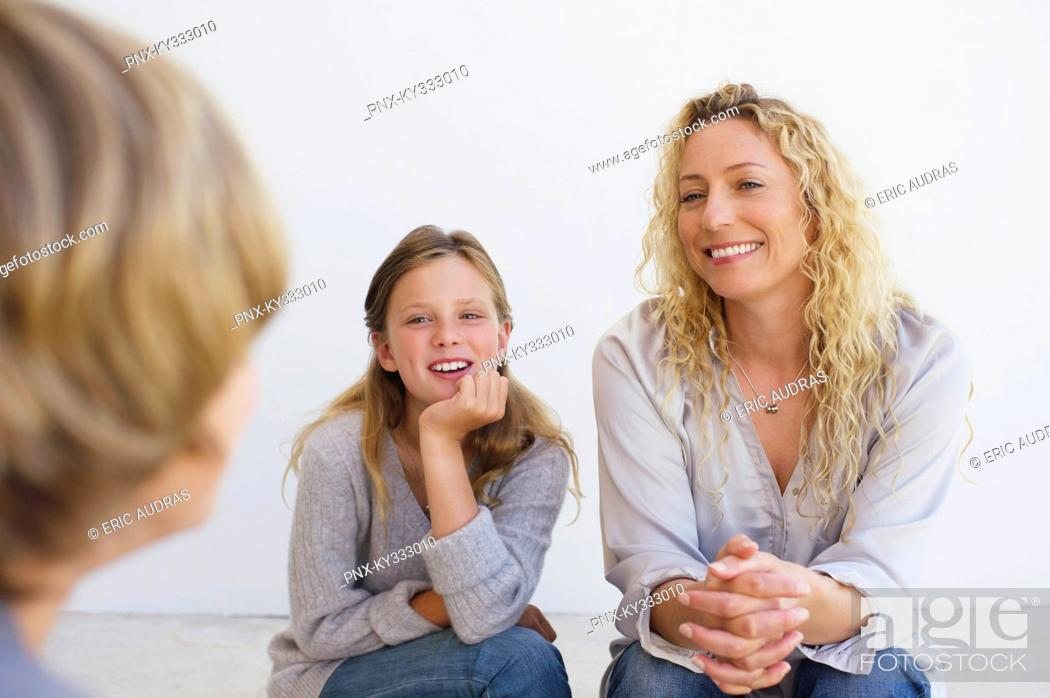 Stock Photo: Mid adult woman talking to her son and daughter at home.