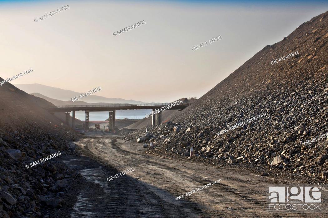 Stock Photo: Bridge spanning road in quarry.