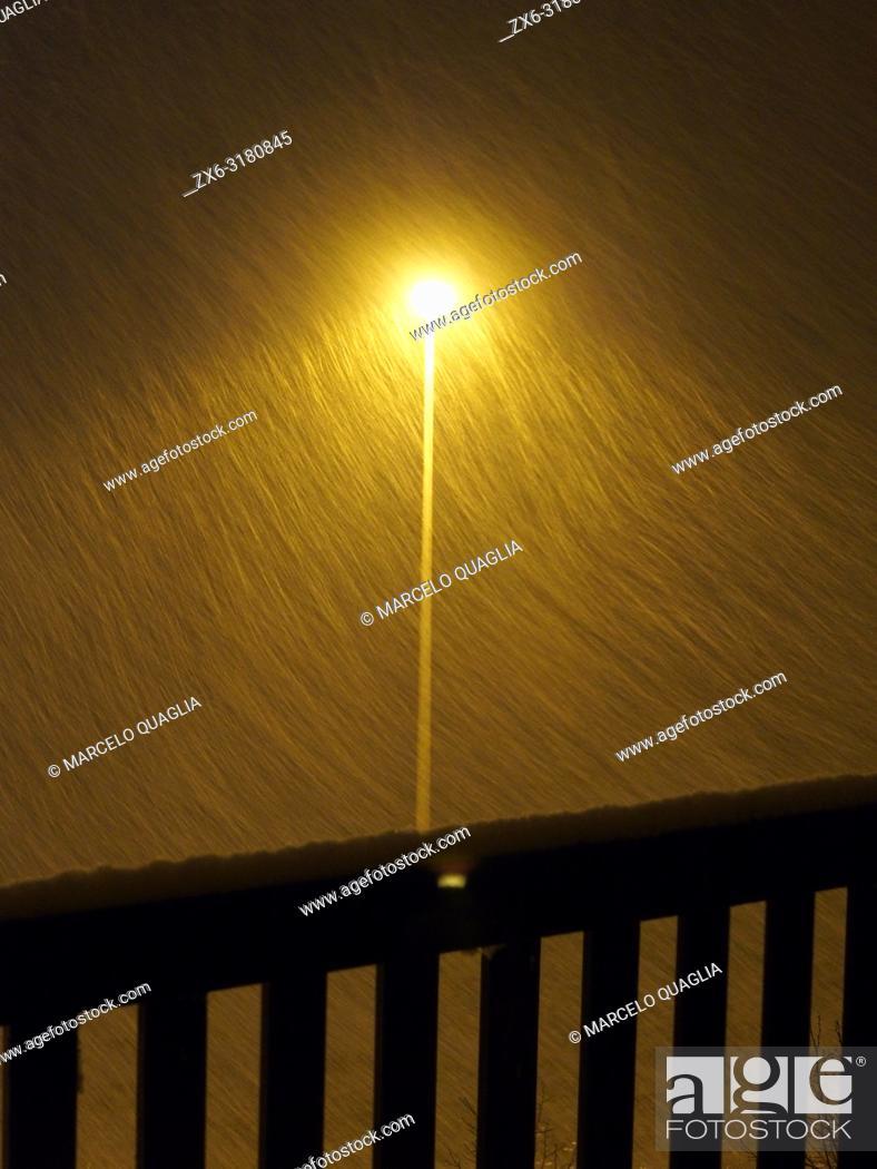 Stock Photo: Snow storm and street lamp post at night. Santa Eulàlia village. Lluçanès region, Barcelona province, Catalonia, Spain.