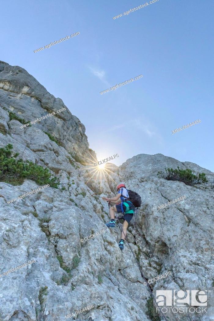 Stock Photo: Europe, Italy, Veneto, Agordo, mountain climber on the via ferrata Fiamme Gialle at Palazza Alta of Pelsa, Civetta group, Dolomites.