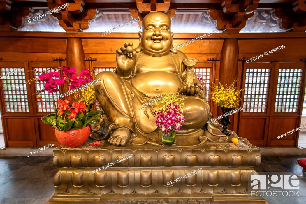 Stock Photo: A statue in the Jing'an Temple surrounded by generous offerings , Shanghai, China.
