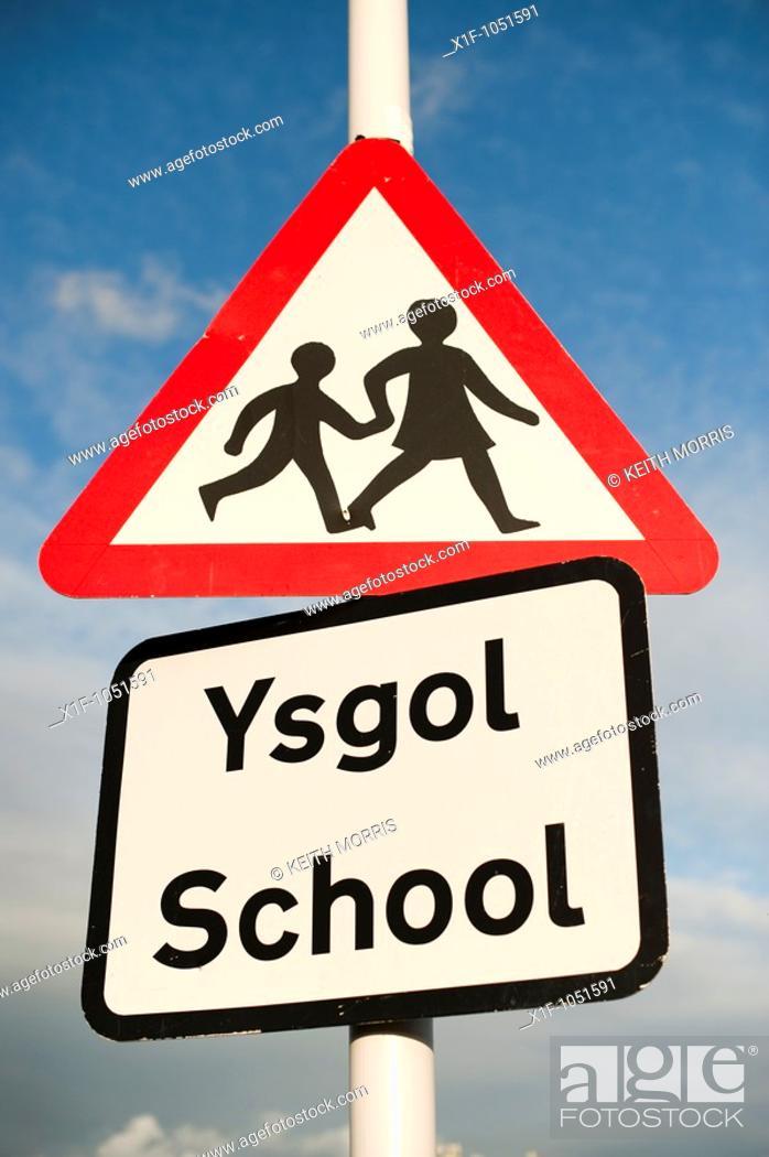 Stock Photo: Bilingual sign school ysgol - welsh englsih warning triangle.