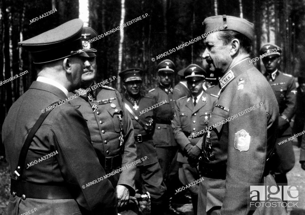 Stock Photo: Adolf Hitler, Wilhelm Keitel and Carl Gustaf Mannerheim. Adolf Hitler talking to the German field marshal Wilhelm Keitel and the Finnish marshal Carl Gustaf.
