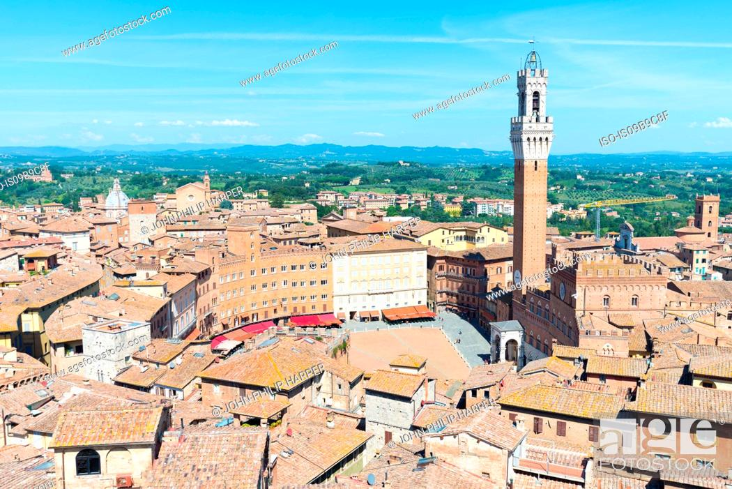 Stock Photo: Cityscape view of rooftops and Torre del Mangia, Siena, Tuscany, Italy.