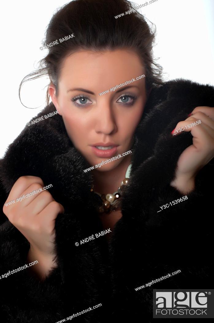 Stock Photo: Beautiful woman in fur coat.