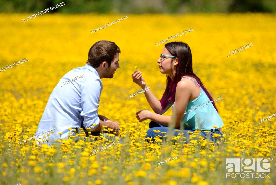 Stock Photo: Young couple enjoying the nature in a yellow field.
