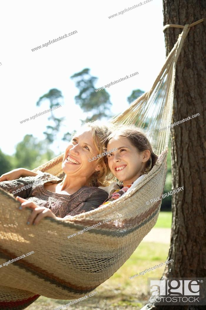 Stock Photo: Mother and daughter laying in hammock.