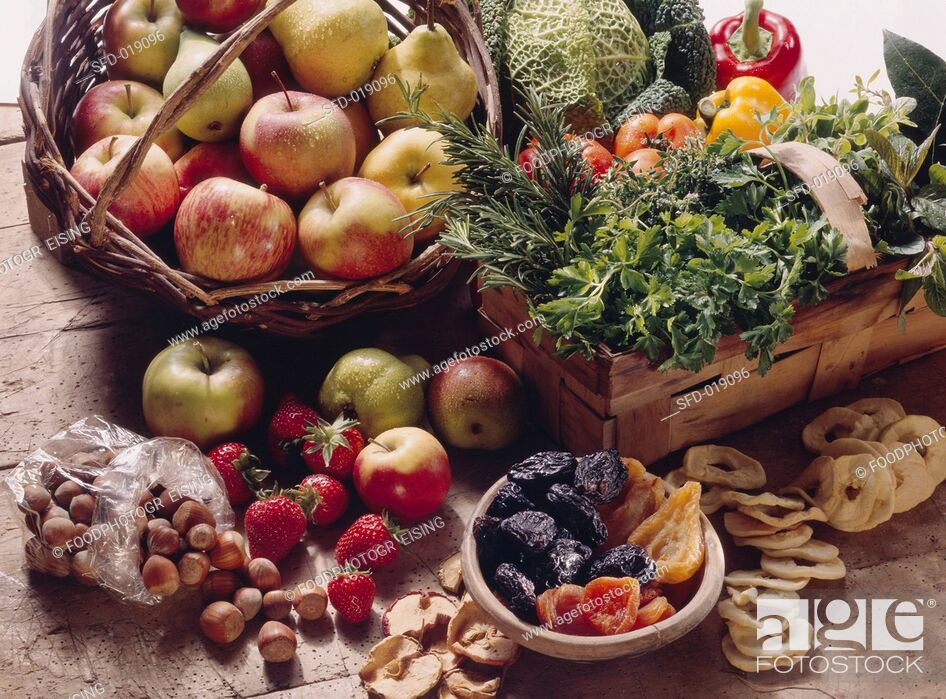Stock Photo: Still Life with Fruit and Vegetables, Herbs and Nuts.