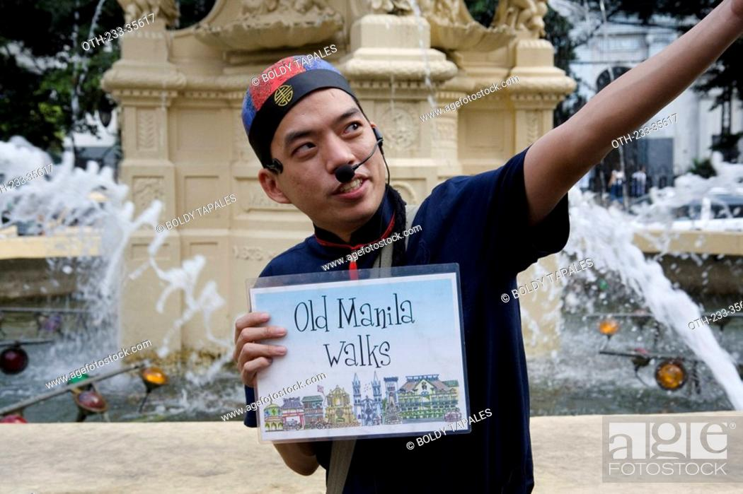 Bataan, philippines jun 30,2018: tour guide to guide tourists.