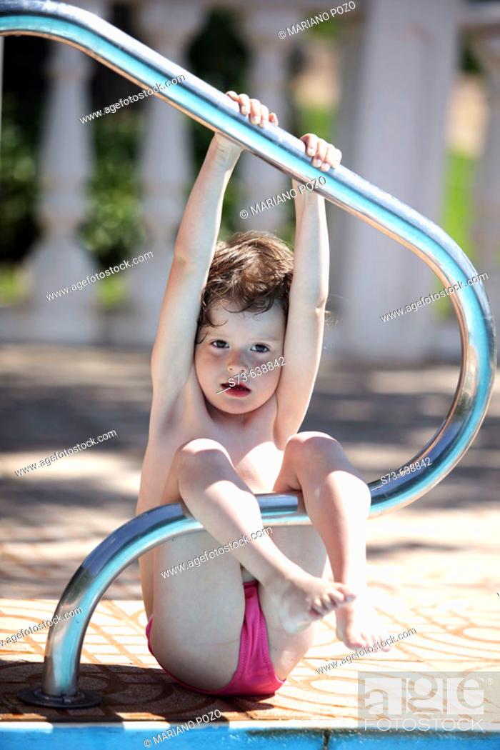 Stock Photo: 4 years old girl in swimming-pool.