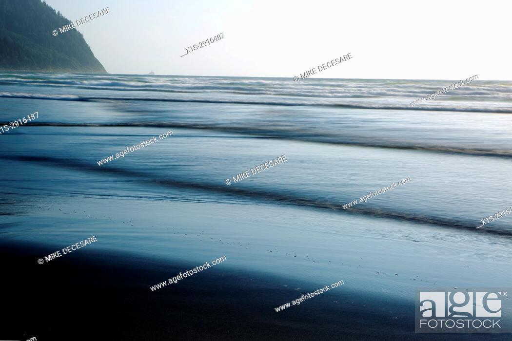Stock Photo: Rising tide along the Oregon Coast creates layers of waves coming to shore.