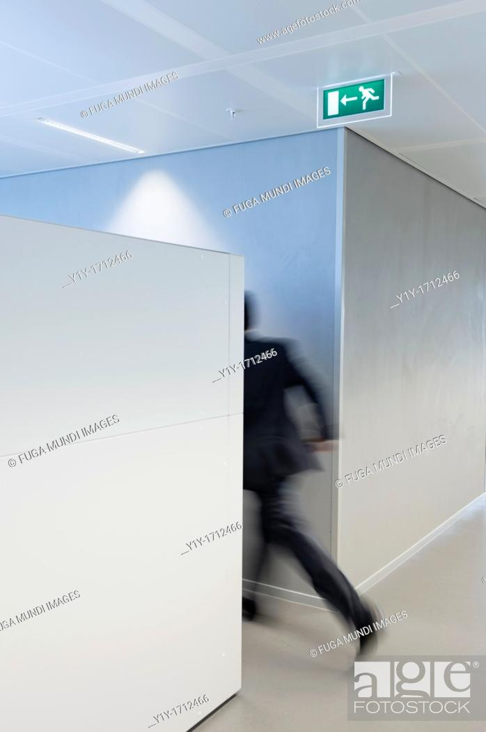 Stock Photo: Businessman rushing towards the exit door.