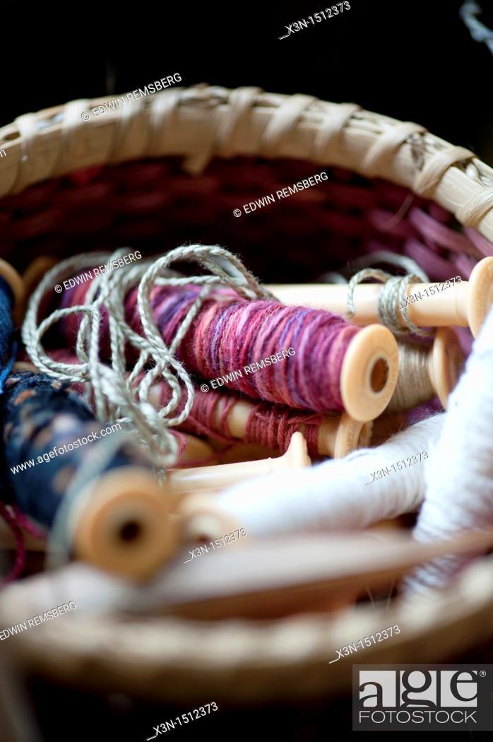 Stock Photo: Basket of spools of thread.