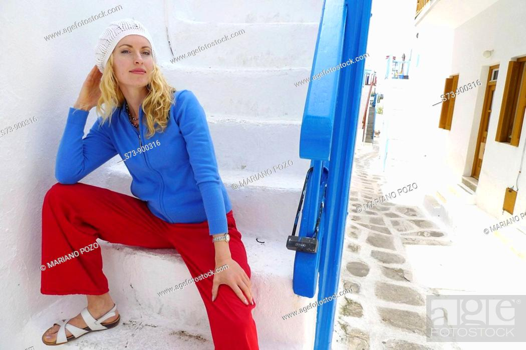 Stock Photo: 30 year old woman in a Mykonos street, Cyclades Islands, Greece, Europe.