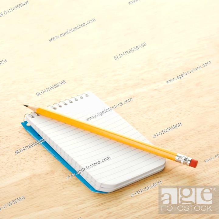 Stock Photo: Pencil on top of open spiral bound notepad.