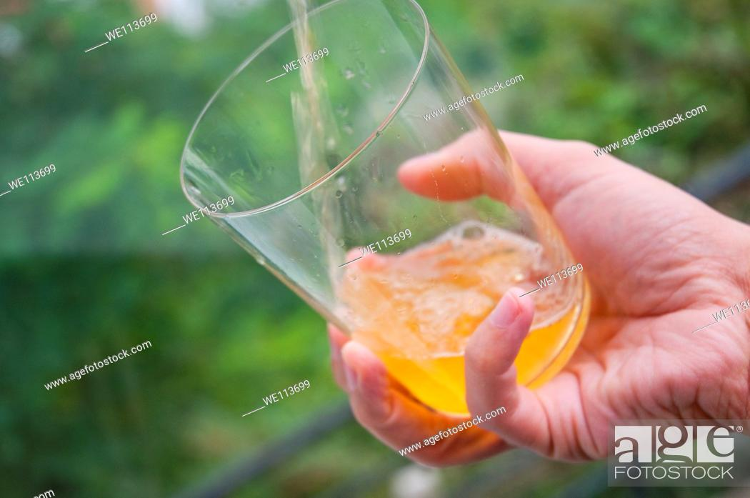 Stock Photo: Man's hand serving cider. Asturias, Spain.