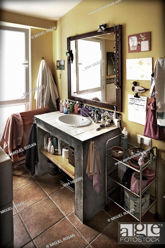 Stock Photo: Detail of the sink and mirror in the bathroom with the accessories of daily use.