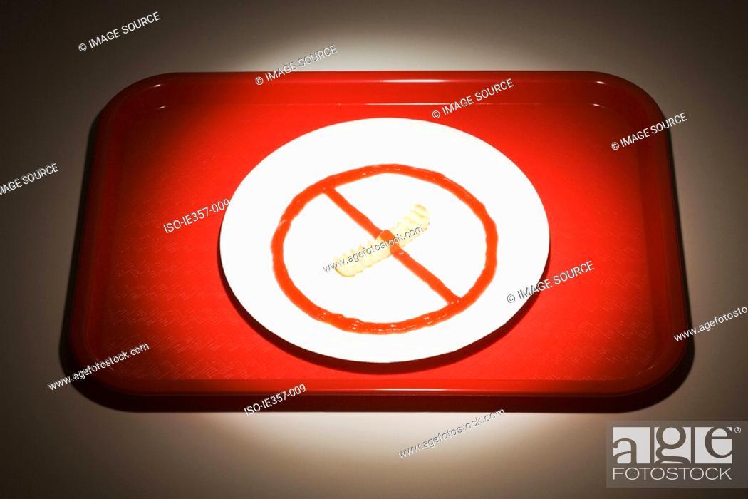 Stock Photo: Food arranged on a plate like a no smoking sign.