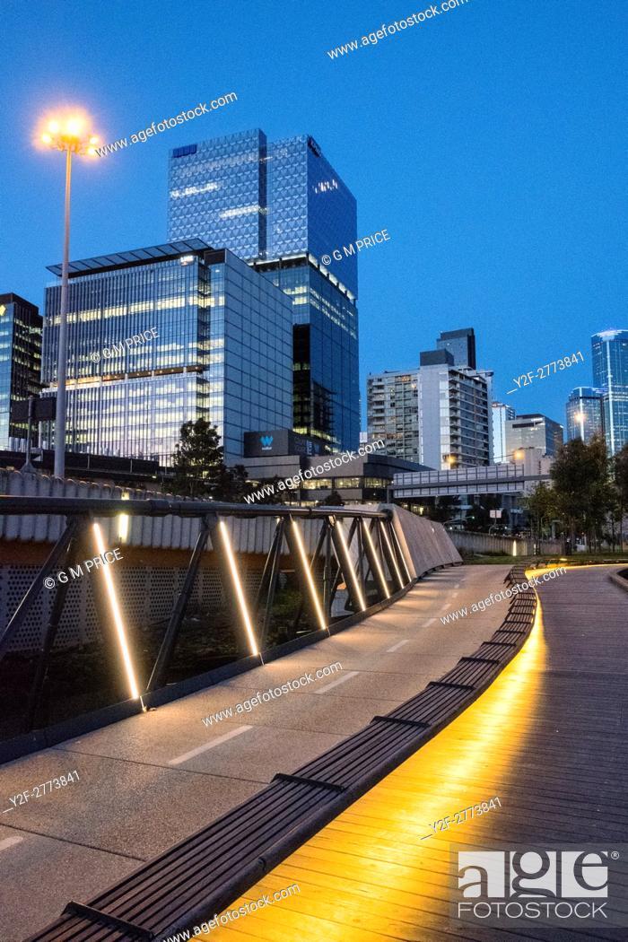 Stock Photo: Jim Stynes Bridge, with Melbourne skyline.