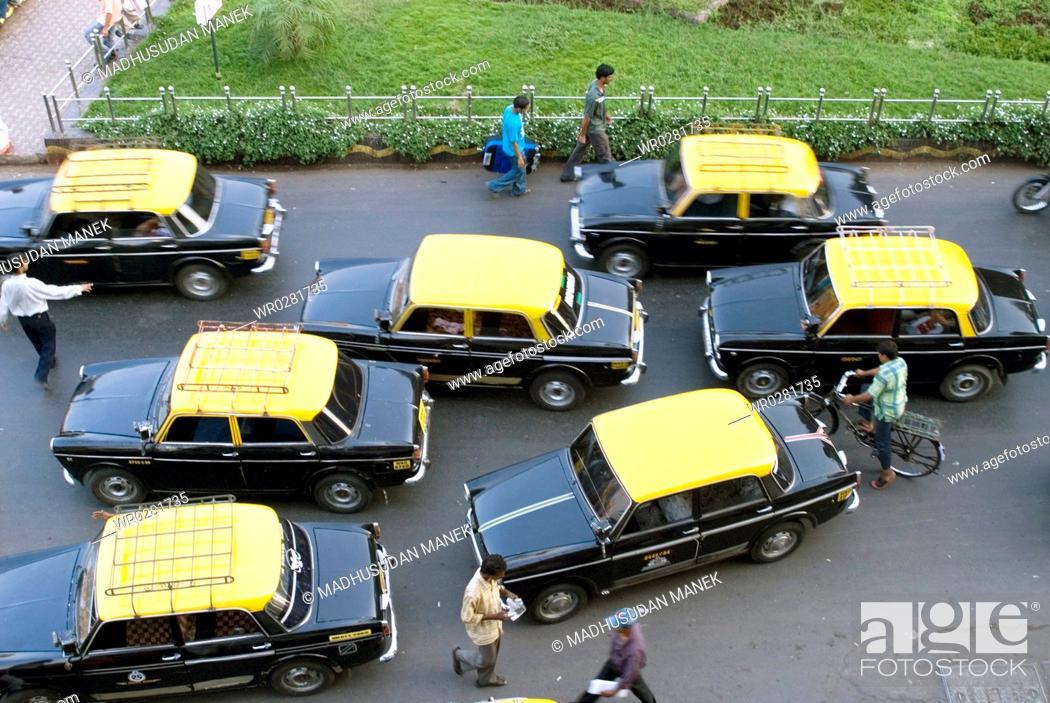 Imagen: Yellow top and black body seven taxies in Bombay Mumbai , Maharashtra , India.