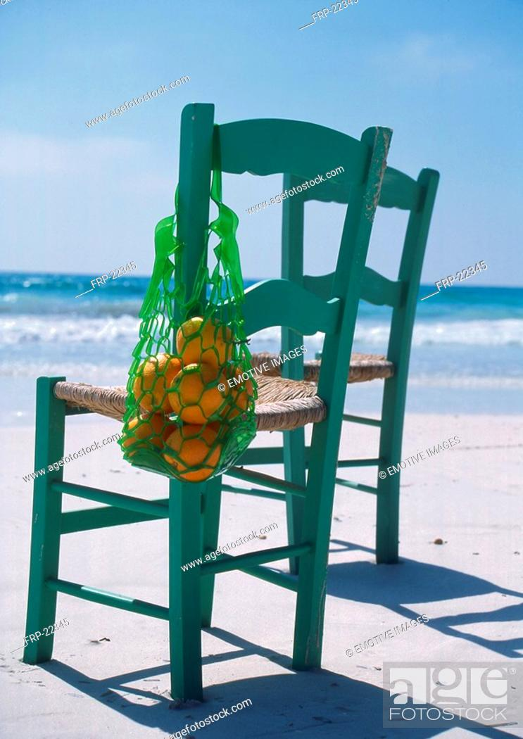 Stock Photo: Two chairs at the beach.