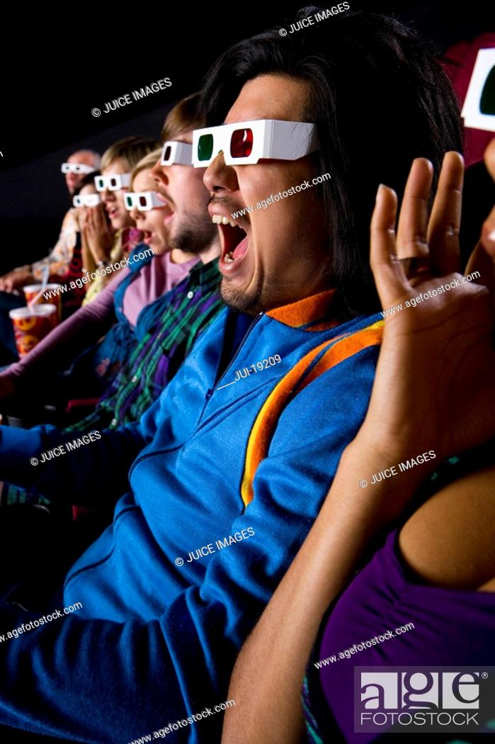 Stock Photo: Audience in cinema wearing 3D glasses, making faces, close-up.