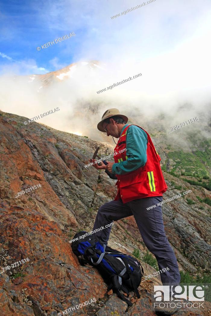 Stock Photo: Geologist doing field work, Hudson Bay mountain, Smithers, British Columbia.