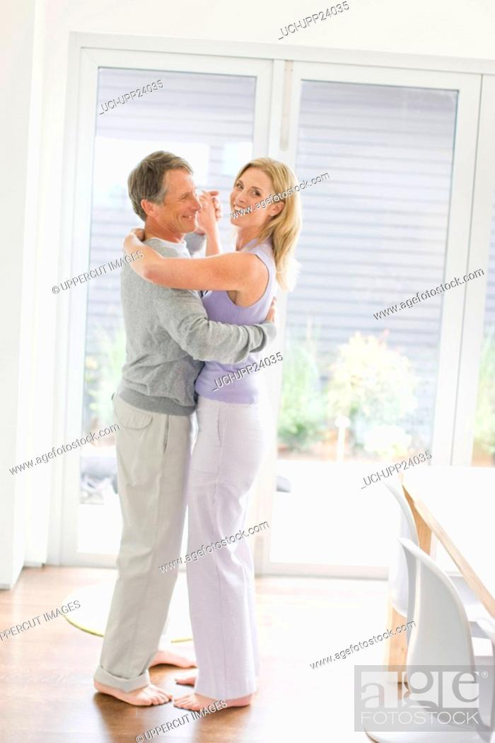 Stock Photo: Portrait of couple dancing in dining room.