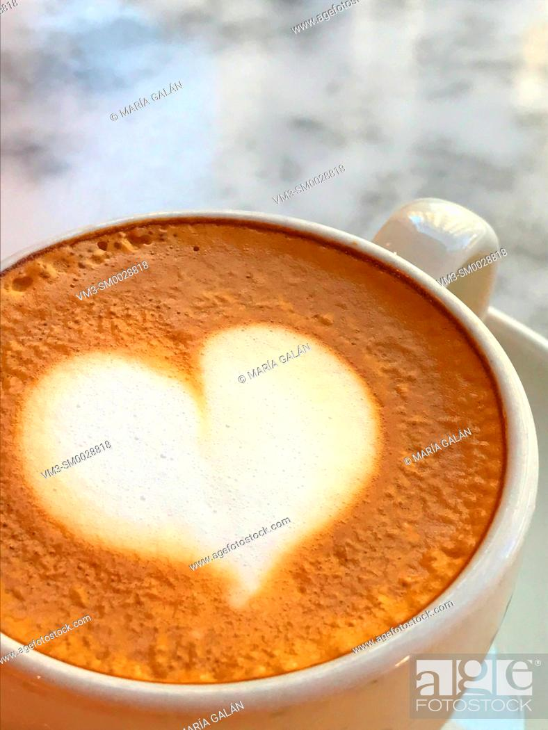 Stock Photo: Heart shape in foam of a coffee cup. Close view.