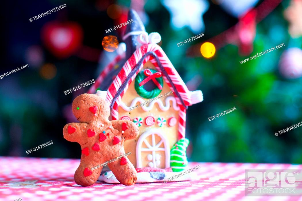 Christmas Gingerbread House Background.Gingerbread Man In Front Of His Candy Ginger House