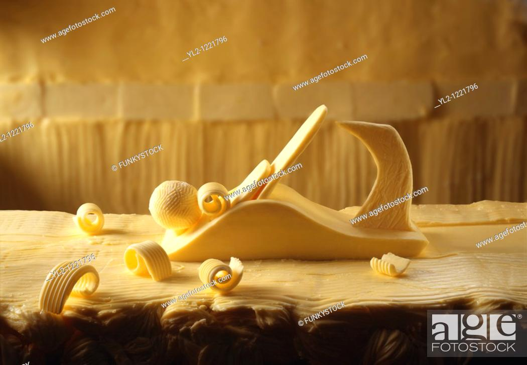 Stock Photo: Plane made out of butter on a bitter worktop with butter curls.