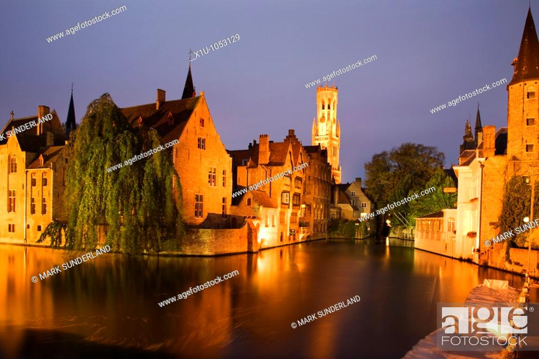 Stock Photo: River Dijver and The Belfort at Dusk Bruges Belgium.