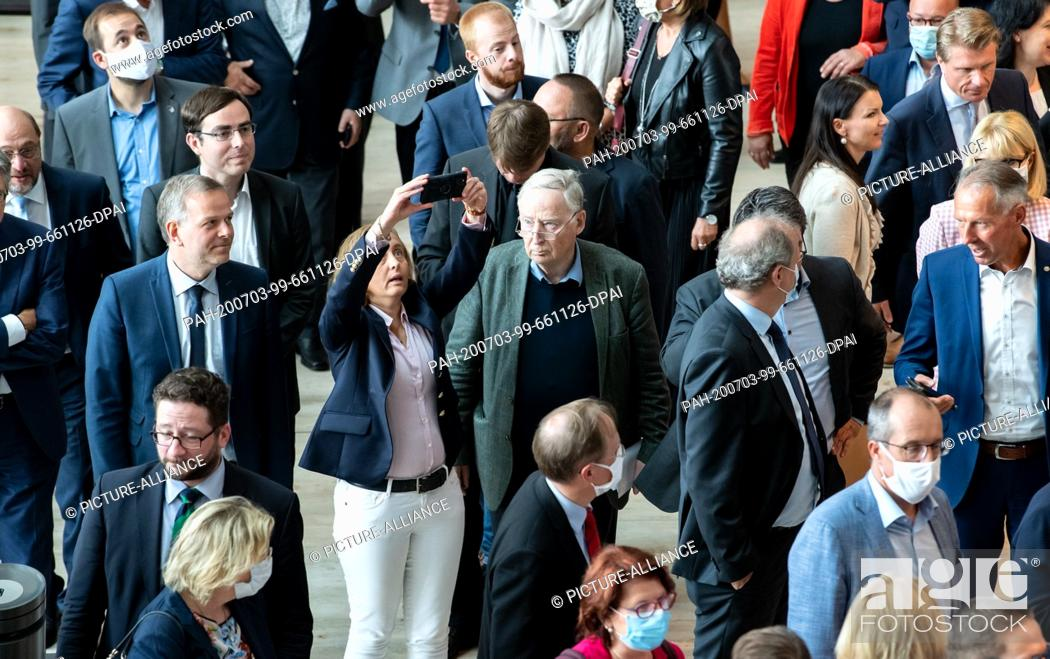 Stock Photo: 03 July 2020, Berlin: Alexander Gauland (M), Chairman of the AfD parliamentary group, and Beatrix von Storch (AfD) stand together with numerous other members of.