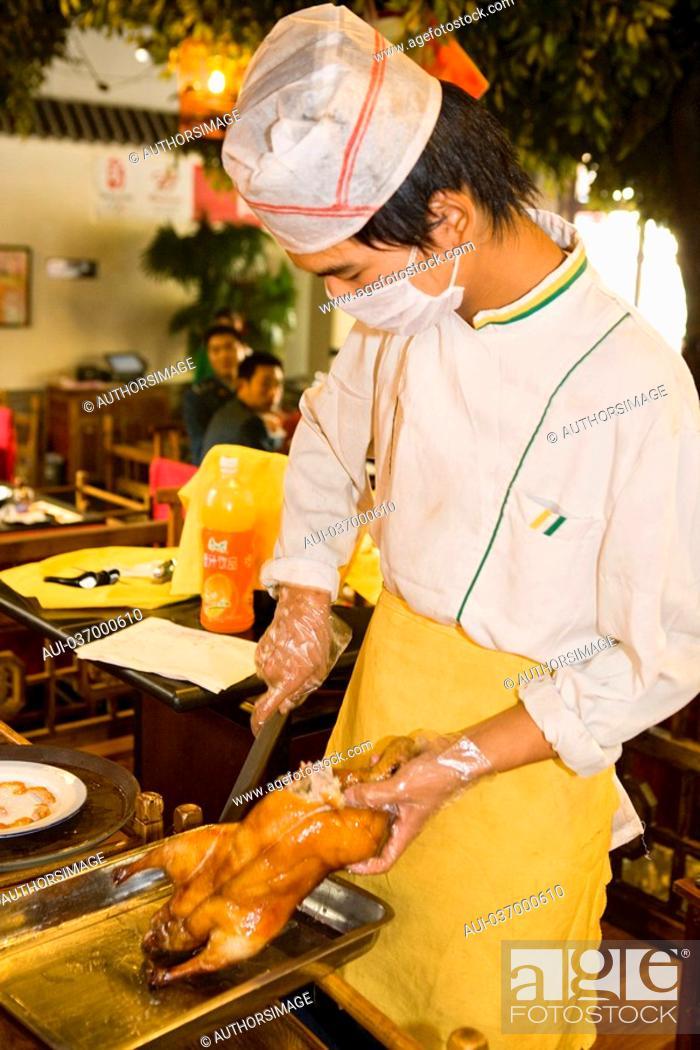 Stock Photo: China - Beijing PÚkin - 'Beijing Quanjude Hepingmen Roast Duck Restaurant' - PÚkin Roast Duck slicing.