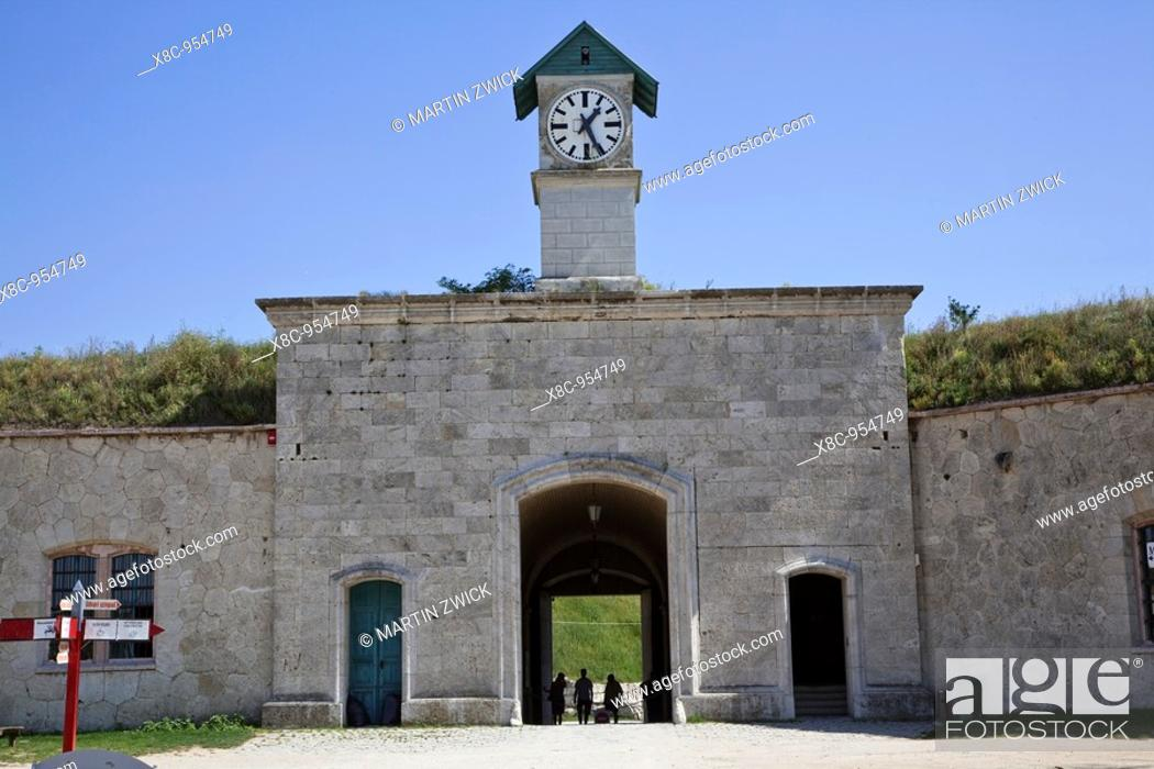 Stock Photo: Fort Monostor in Komarom Monostori Eroed, Hungary  Main gate with clock seen from the inner yard  The fort was built from 1850 onwards  The main purpose for the.