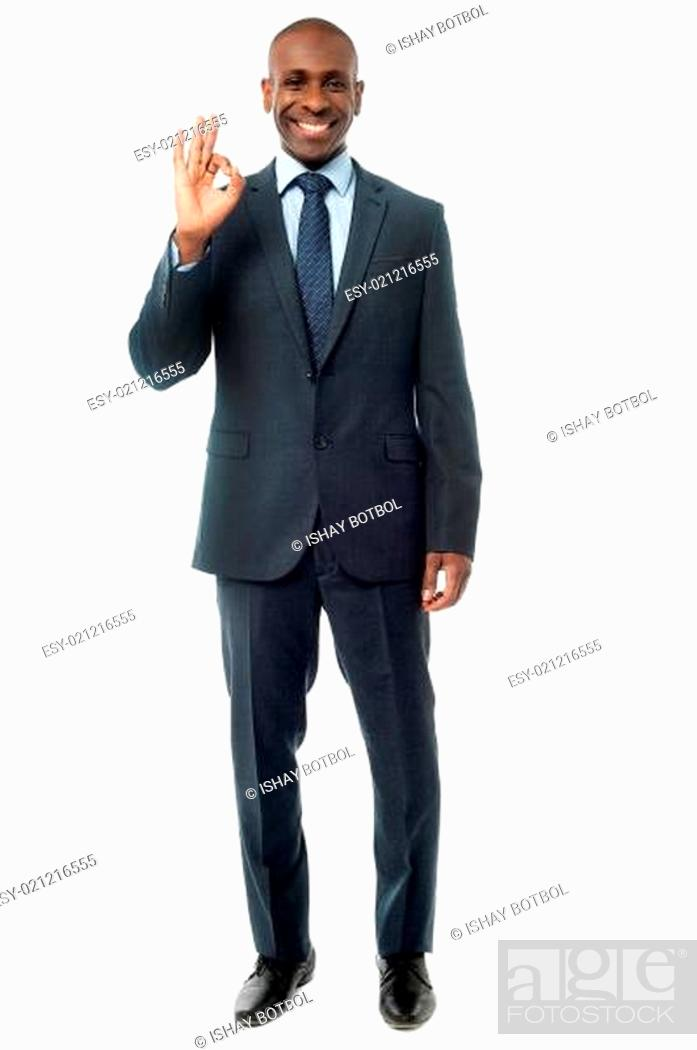 Stock Photo: Businessman showing okay sign.