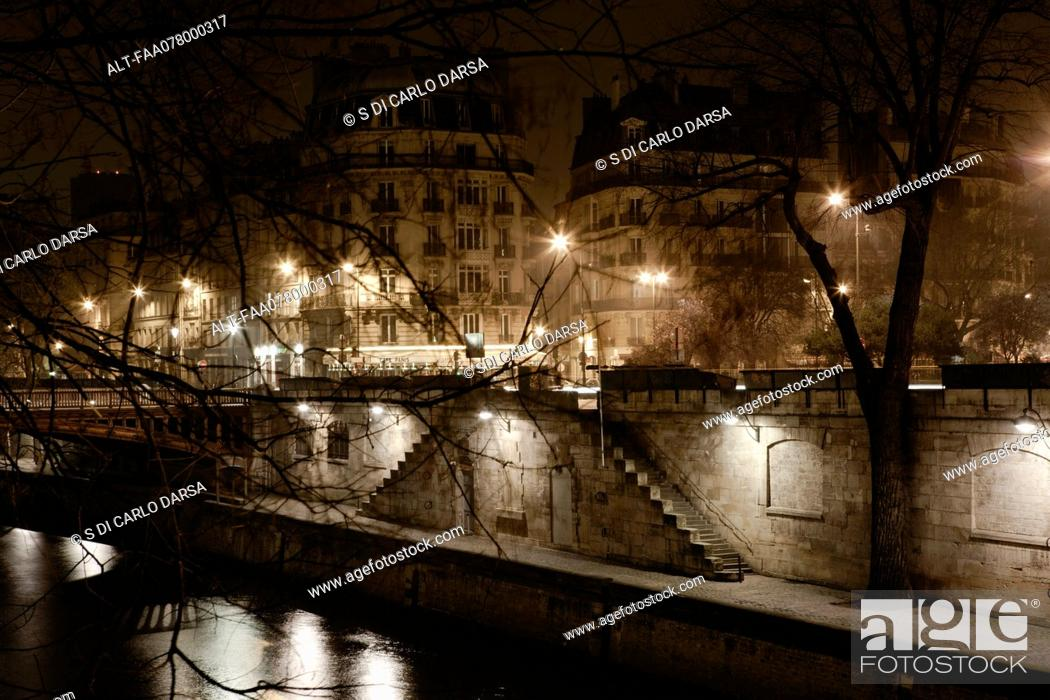 Stock Photo: Bank of Seine river by night, Paris, France.