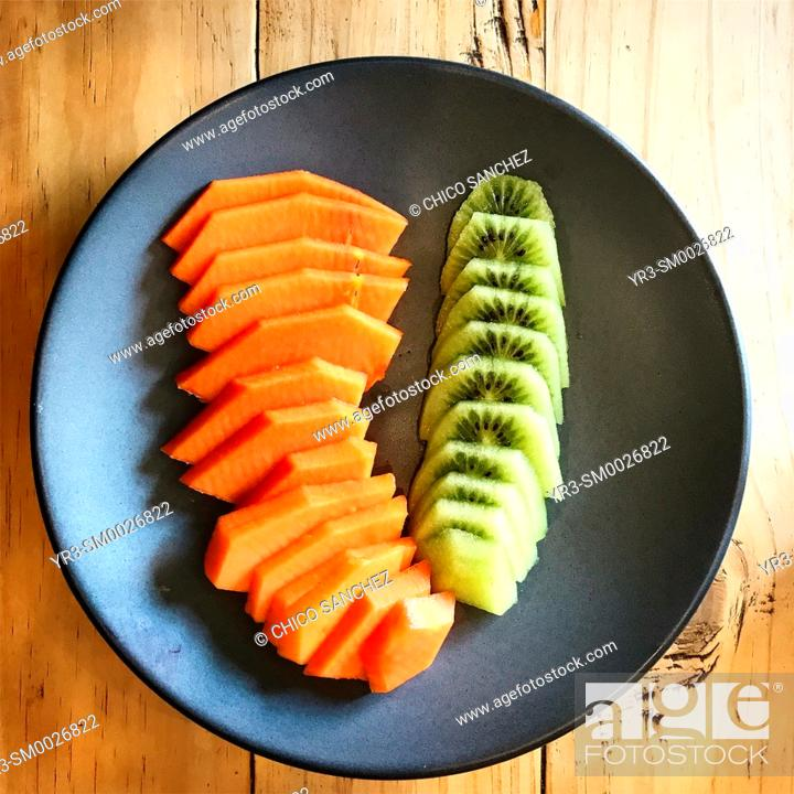 Stock Photo: Papaya and kiwi fruit in a restaurant in Spain.