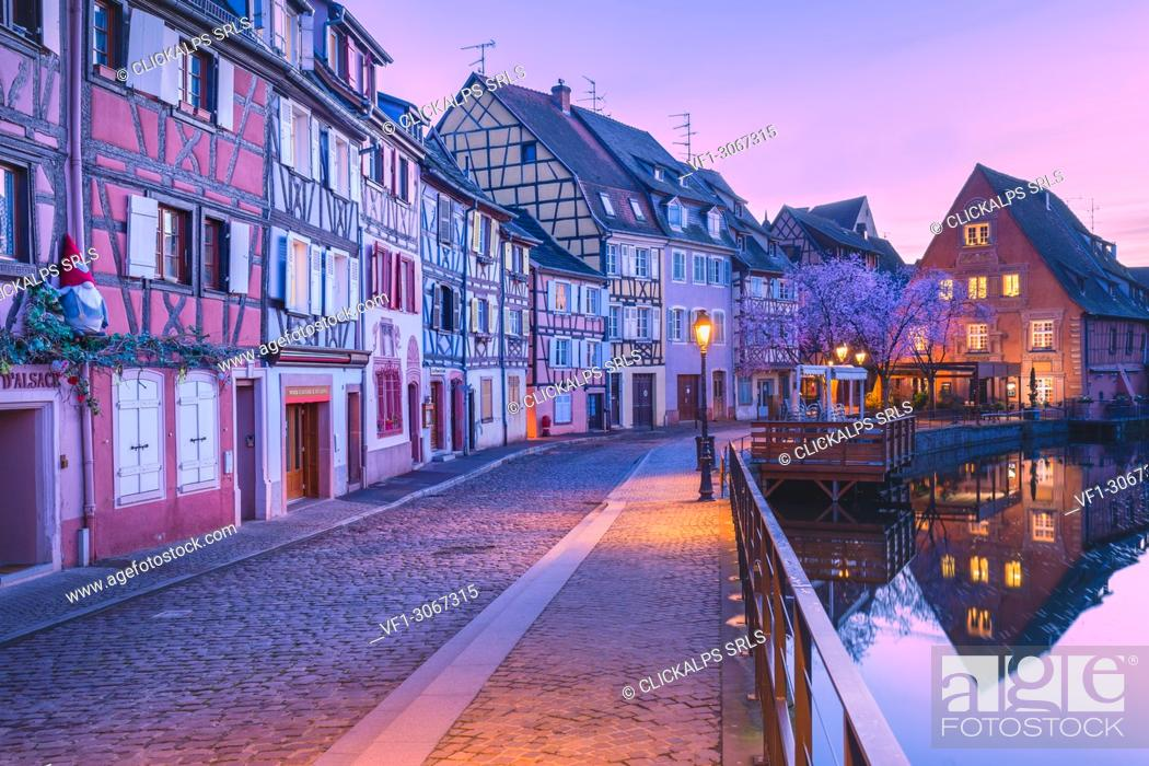 Stock Photo: Canal waterfront view of traditional townhouses at dusk, Colmar, Grand Est, France.