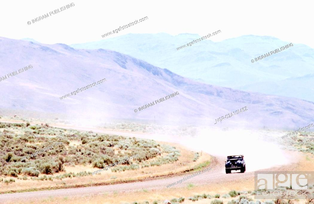 Stock Photo: Off Road Vehicle on Dirt Road.