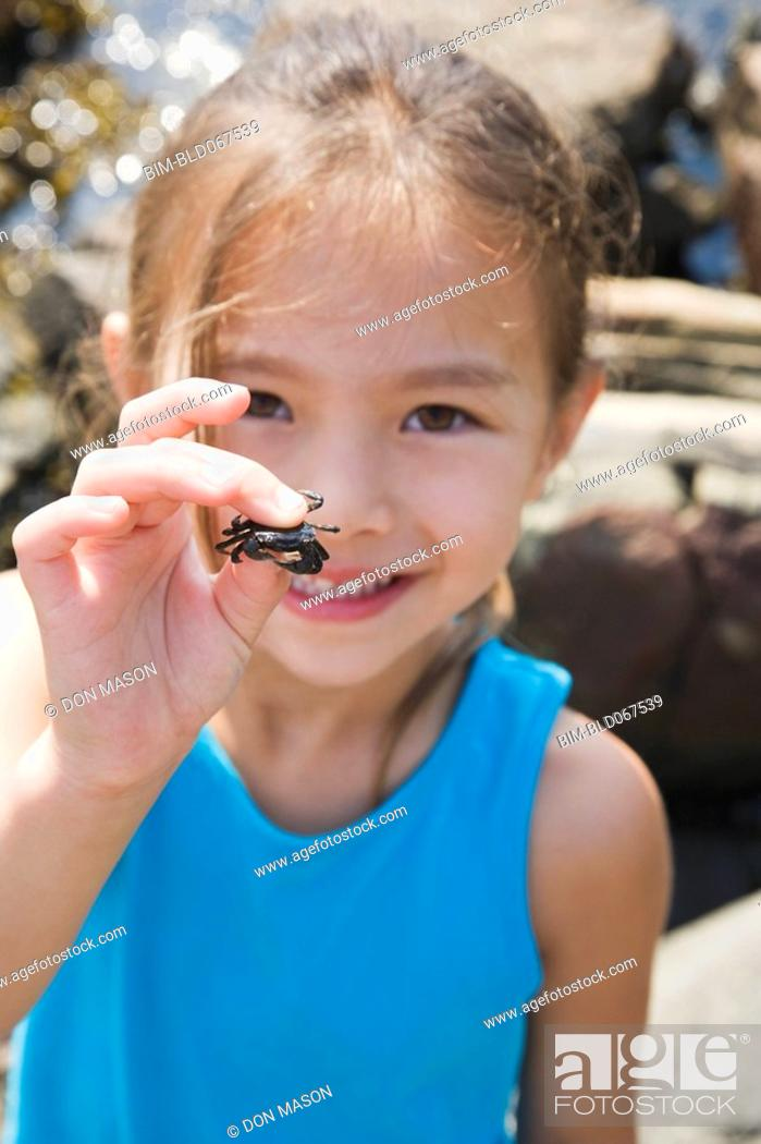 Stock Photo: Asian girl holding tiny crab.