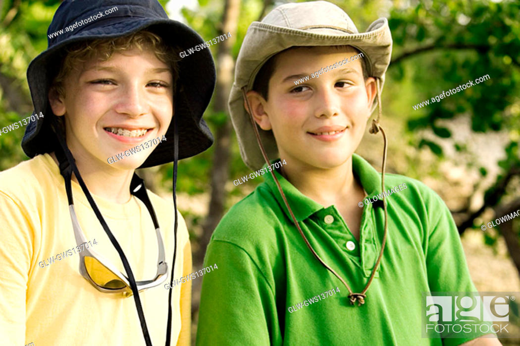 Stock Photo: Close-up of two boys smiling.