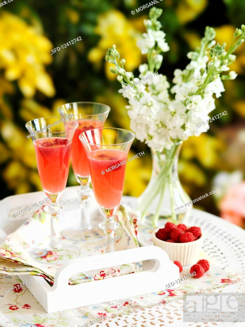 Stock Photo: Champagne cocktail with raspberries.