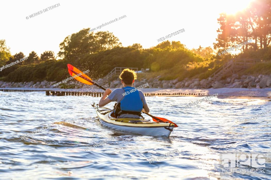 Stock Photo: Denmark, Young man kayaking.