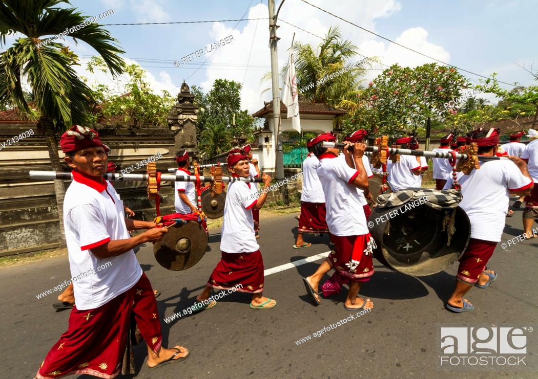 Stock Photo: Gamelan orchestra in a ceremonial procession, Baha, Bali, Indonesia.