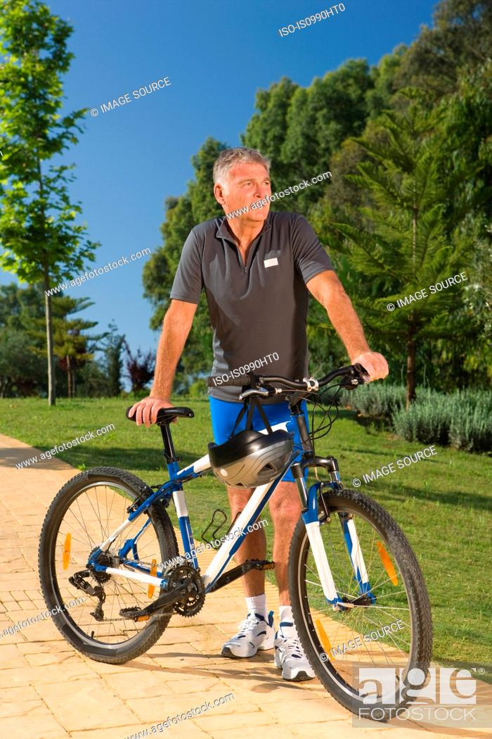 Stock Photo: Senior male cyclist with bicycle.