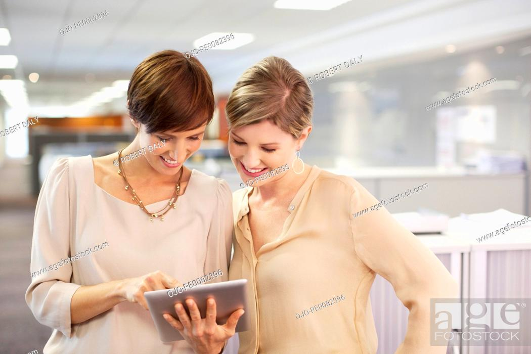 Stock Photo: Businesswomen with digital tablet in office.